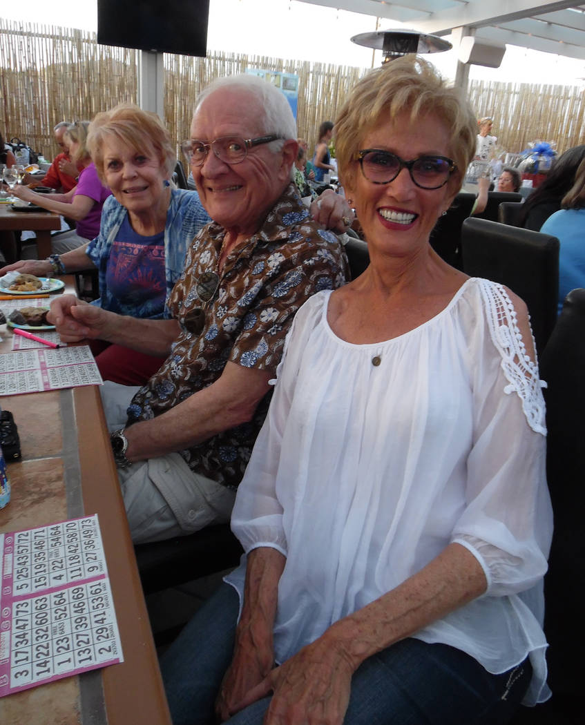 Hali Bernstein Saylor/Boulder City Review Enjoying an evening of dinner and games at Bow Wow Bingo presented by See Spot Run on Saturday were, from left, Dar Medina, Jack Medina and Cokie Booth.