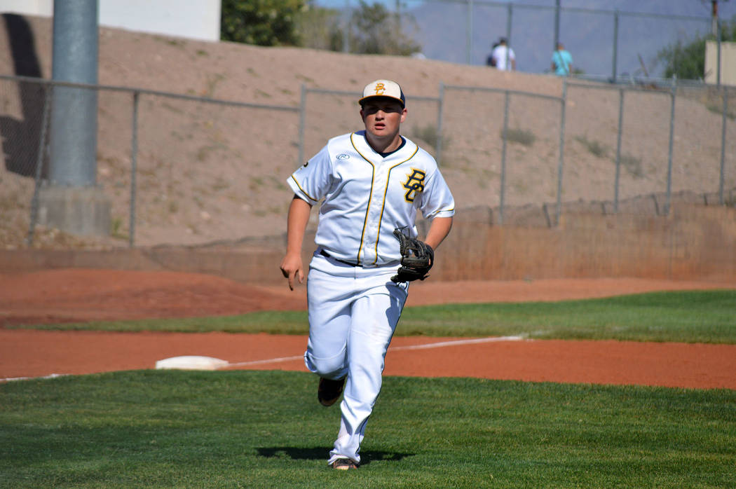 Celia Shortt Goodyear/Boulder City Review Junior Nolan Herr runs to catch a ball during Boulder City High School's Tuesday home game against Moapa Valley. The Eagles won 7-5.