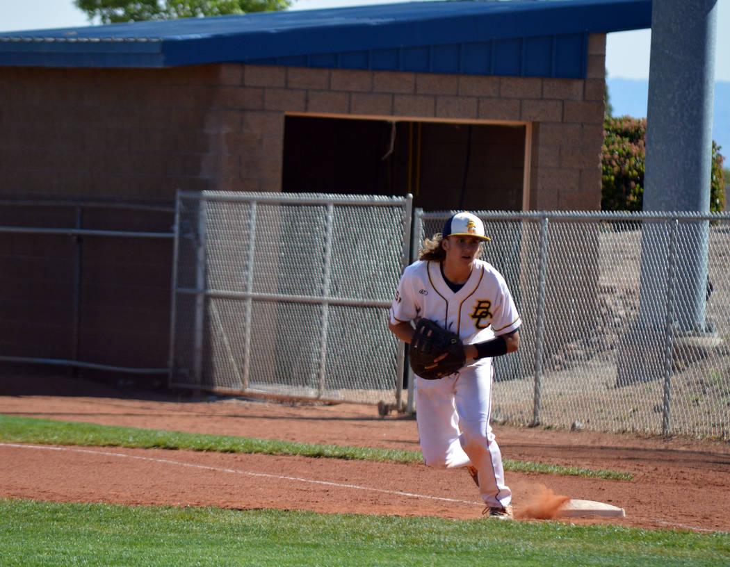 Celia Shortt Goodyear/Boulder City Review First baseman, senior Aaron Kehoe, runs to field a ball during Boulder City High School baseball team's home game Tuesday.