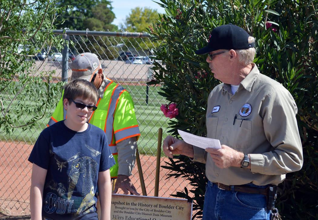 Celia Shortt Goodyear/Boulder City Review David Duncan of Boulder City's landscape department, quizzes his son, Mitchell Duncan, about Arbor Day.