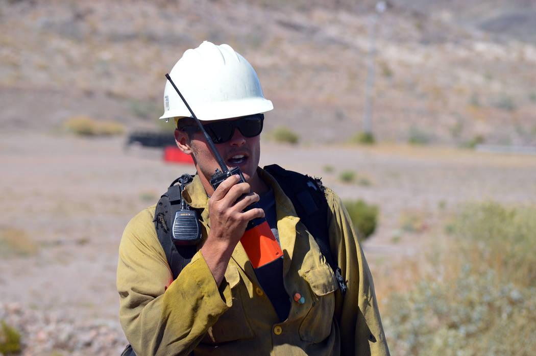 Celia Shortt Goodyear/Boulder City Review Jason Douglas gets the details of the scenario he and other wildland firefighters participated in at Lake Mead National Recreational Area for Wildland Fir ...