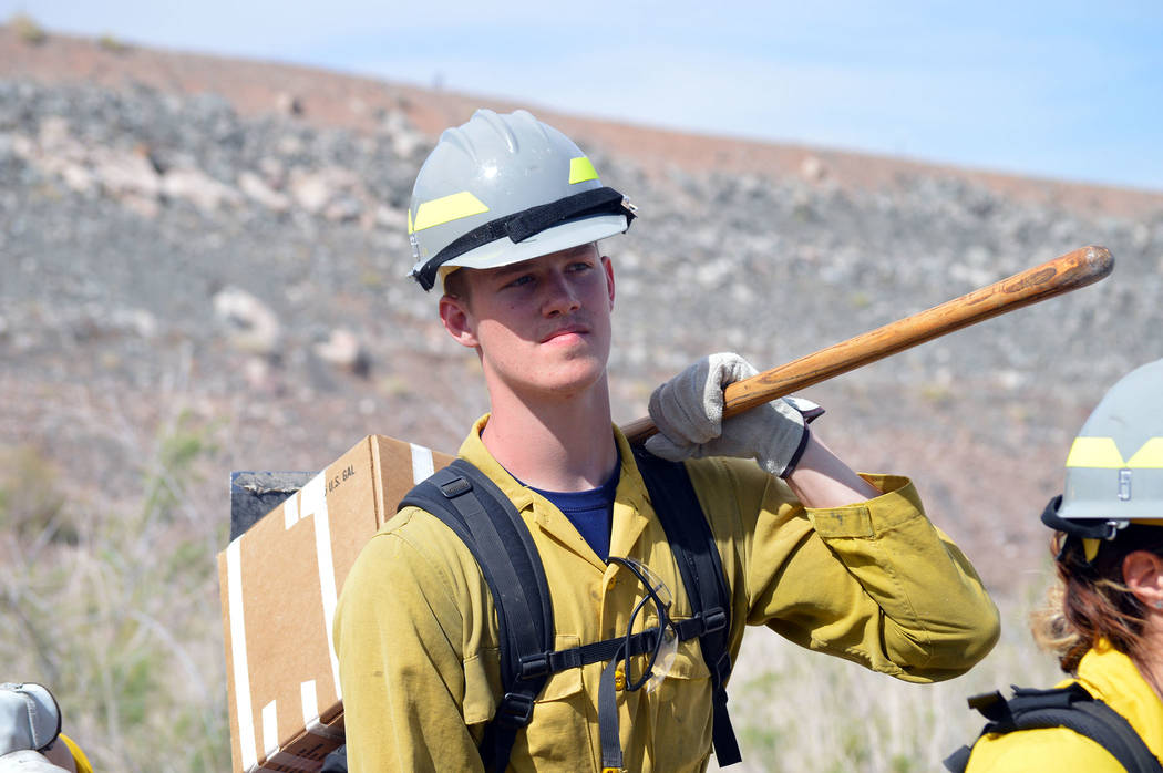 Celia Shortt Goodyear/Boulder City Review Zack Child waits with his crew to start putting is firefighting skills into practice at Lake Mead National Recreation Area on April 27. The event was part ...