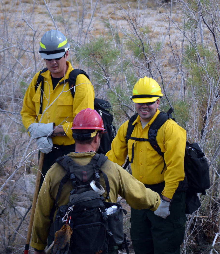 Celia Shortt Goodyear/Boulder City Review Colin Gundle, center, gives direction to Joshua Shuler, left, and Matthew Medoff as they prepare to hone their firefighting skills.