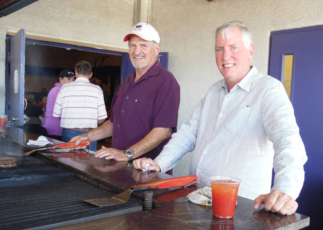 Hali Bernstein Saylor/Boulder City Review Doug Scheppmann, left, and Dr. Robert Merrell manned the barbecue for Emergency Aid of Boulder City's Mexican Chip Dip Competition on Saturday at the Boul ...