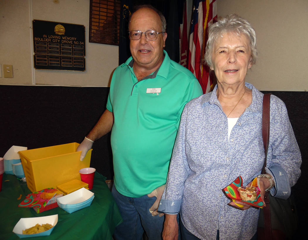 Hali Bernstein Saylor/Boulder City Review Tom Tyler, vice president of Emergency Aid of Boulder City, handed out chips and vegetables to Teresa Krause during Saturday' Mexican Chip Dip Comptition  ...