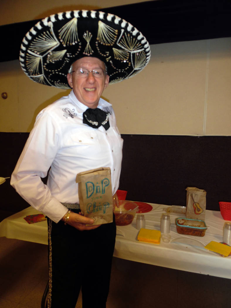 Hali Bernstein Saylor/Boulder City Review Roger Douglas came dressed for the occasion as Emergency Aid of Boulder City hosted its first Mexican Chip Dip Competition on Saturday at the Boulder City ...