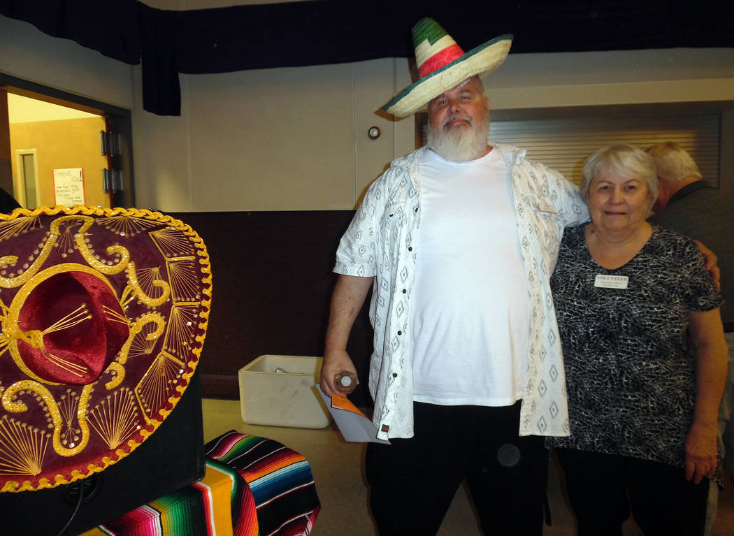 Hali Bernstein Saylor/Boulder City Review Mike Derby, president of Emergency Aid of Boulder City, and volunteer Helen Breeden were on hand to help ensure Saturday's Mexican Chip Dip Competition ra ...