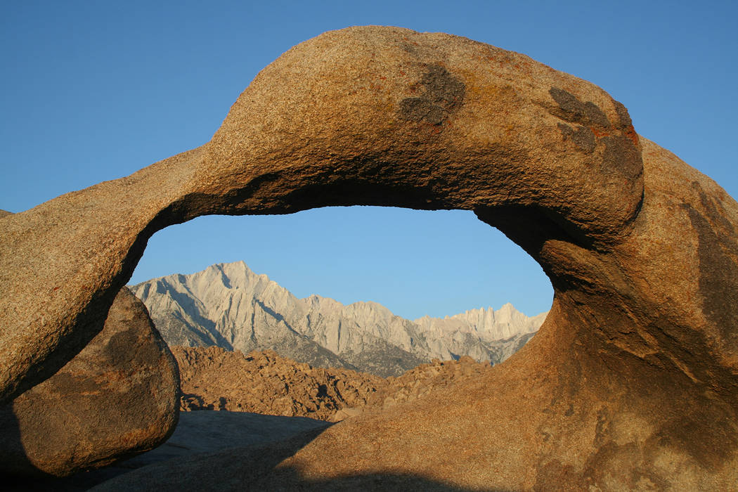 Deborah Wall Lone Pine Peak and Mount Whitney are framed through this arch in the Alabama Hills Recreation Area near Lone Pine, California.