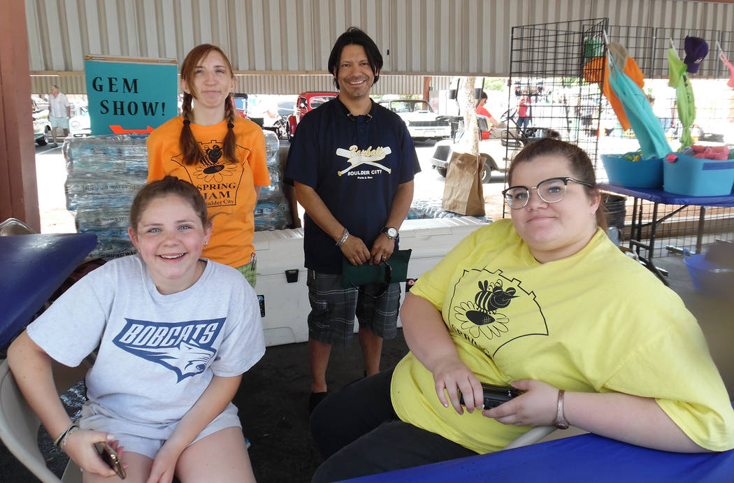 Hali Bernstein Saylor/Boulder City Review Manning the booth offering bottles of cold water during the Spring Jamboree on Saturday were volunteers, from left, Ashlyn Iwinski, Kaitlin Swapp, Larry A ...