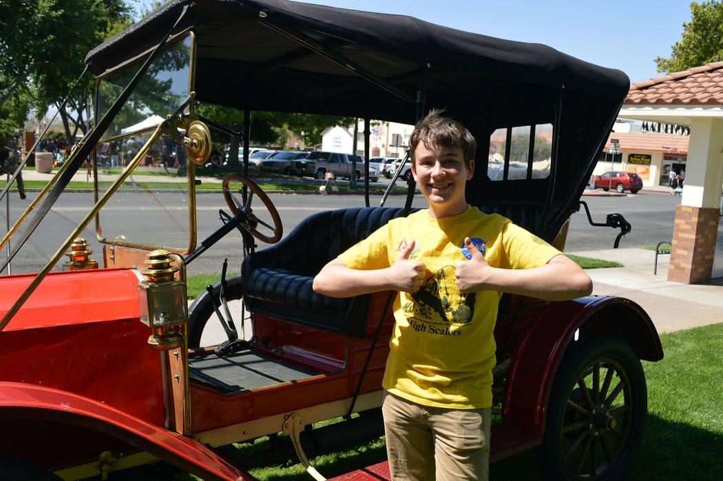 Celia Shortt Goodyear/Boulder City Review Boulder City High School ninth-grader Izaiha Engler enjoys the 1911 Flanders Model 20 at Spring Jamboree in Boulder City. He thinks the car is the best on ...