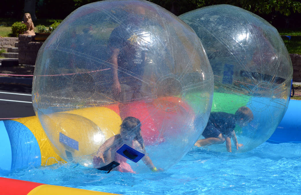 Celia Shortt Goodyear/Boulder City Review Allie Gates, left, and Porter Burr enjoy the Bubble Fun water ride during this year's Spring Jamboree.