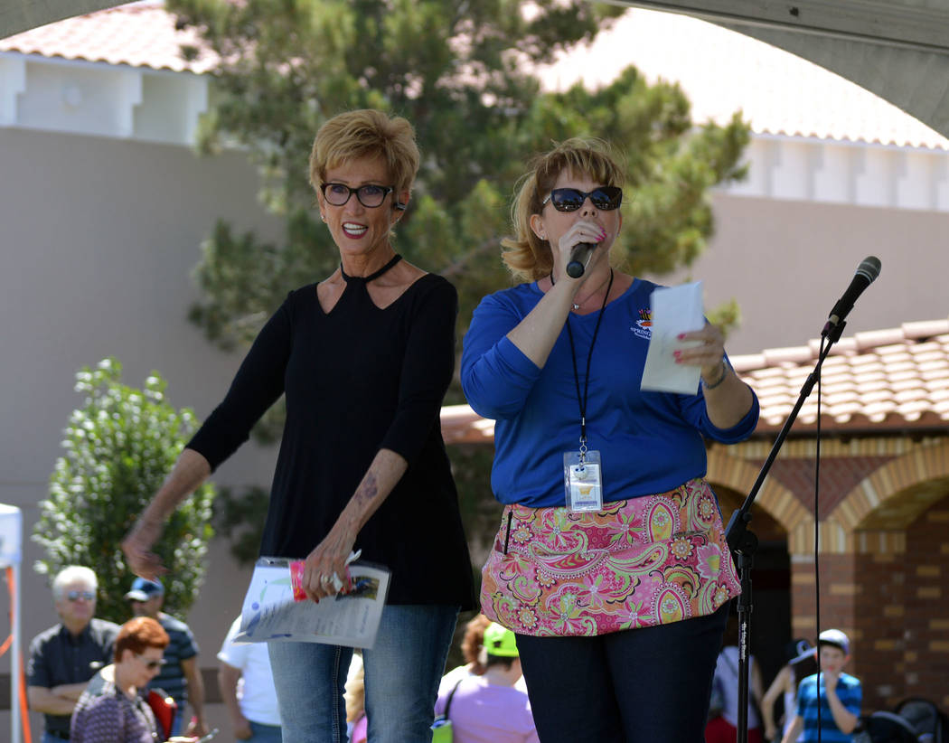 Celia Shortt Goodyear/Boulder City Review Jill Rowland-Lagan, right, CEO of the Boulder City Chamber of Commerce, presents a check for $500 on behalf of the Boulder Police Protection to Cokie Boot ...