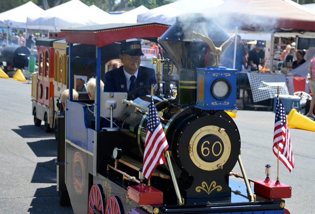 Celia Shortt Goodyear/Boulder City Review Daryl Schelin of the Jupiter Express Railroad drives the train through the Spring Jamboree in Boulder City.