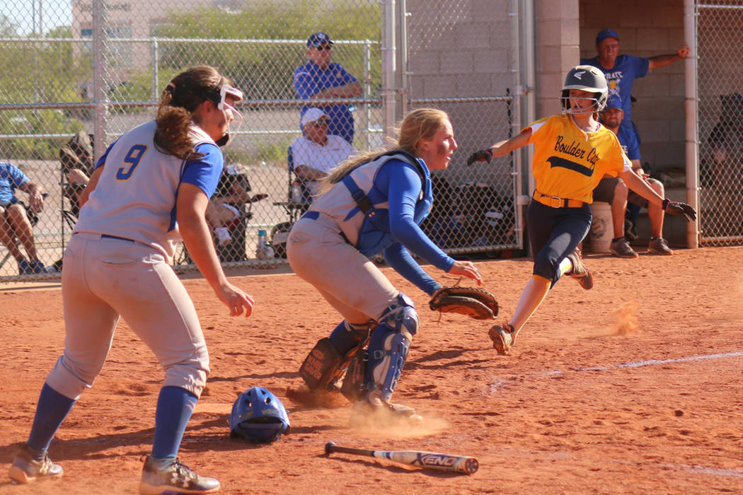 Laura Hubel/Boulder City Review Just beating the throw, pinch runner Keeley Alexander, who was brought up from the junior varsity team for the regional tournament, scores for the Lady Eagles in th ...
