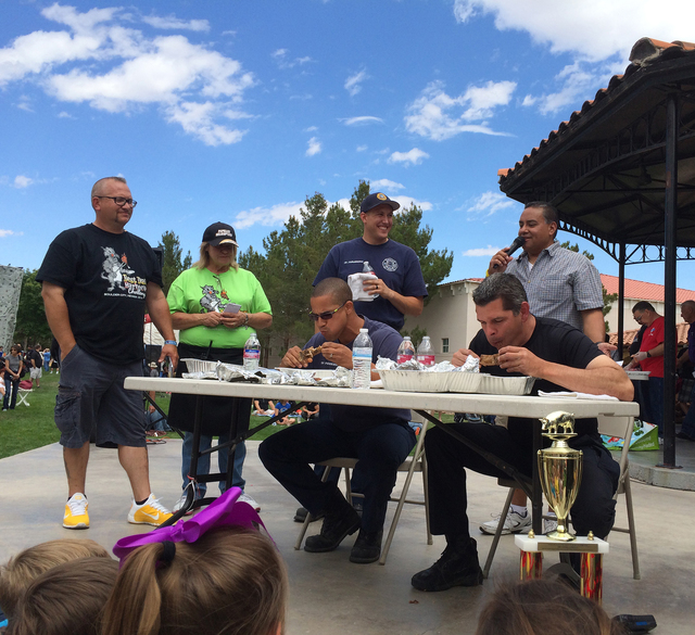 File The Boulder City Fire Department will be seeking its seventh win as it challenges the city's police department in a rib-eating contest at the annual Best Dam Barbecue Challenge on Saturday in ...