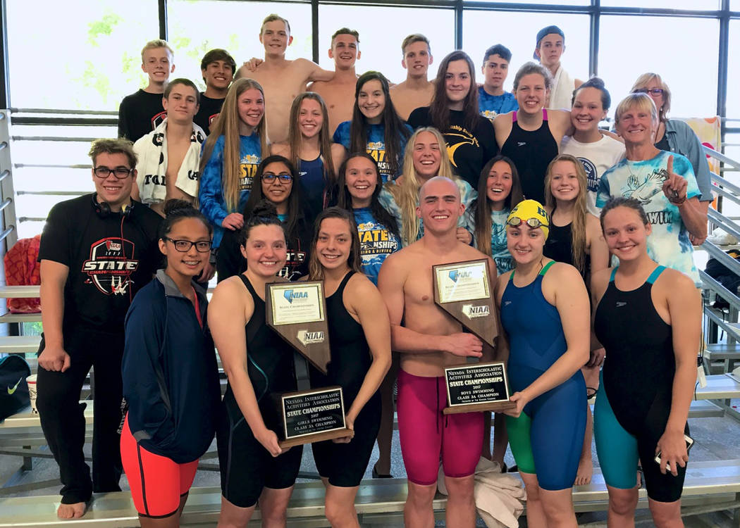 Trish Sauerbrei Boulder City High School's boys and girls swim teams celebrate their state championships after the competition Saturday at the Carson Aquatic Center in Carson City.