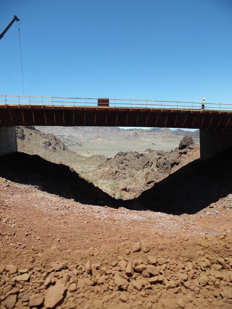 Hali Bernstein Saylor/Boulder City Review Work continues Friday on one of 11 bridges being built as part of Phase 2 of Interstate 11 that will eventually connect Las Vegas with Phoenix, Arizona.