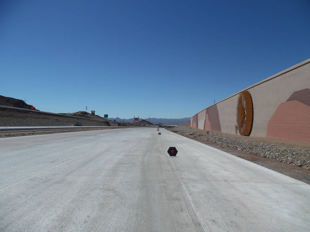 Hali Bernstein Saylor/Boulder City Review Some of the artwork depicting the construction of Hoover Dam on the retaining wall of Interstate 11 near Railroad Pass can be seen from the concrete pavem ...