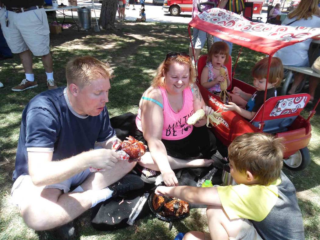 Hali Bernstein Saylor/Boulder City Review John and Amanda Campbell of Henderson, along with their children William, lower right, and twins Juliette and James, sampled some barbecued items offered  ...