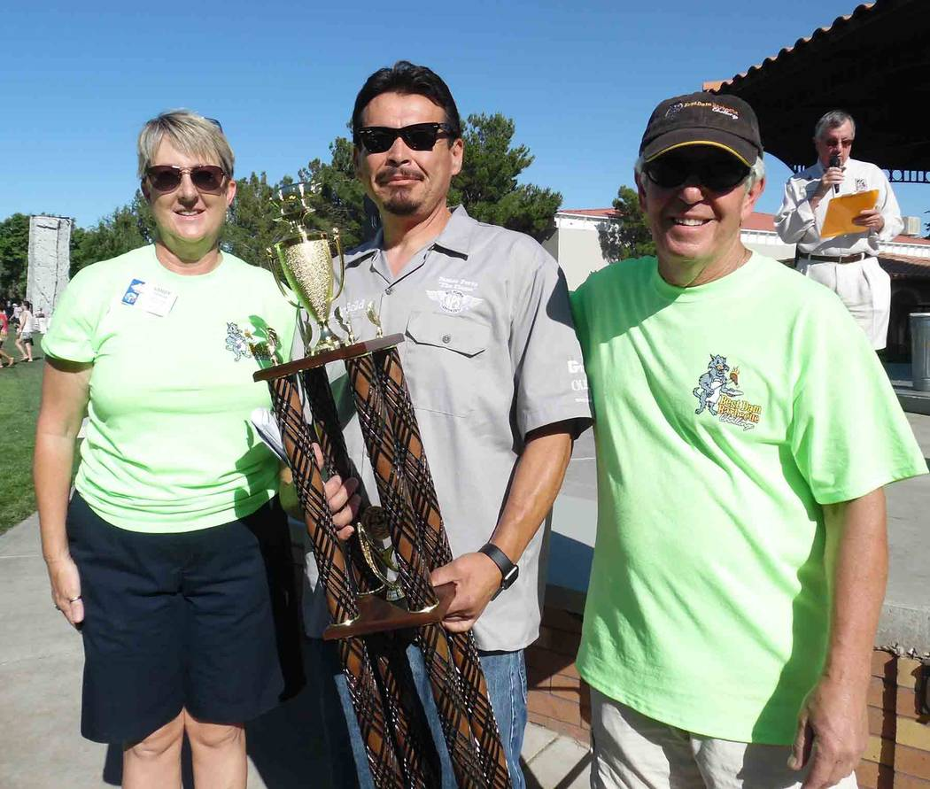 """Hali Bernstein Saylor/Boulder City Review James """"The Flame"""" Perez of Big Poppa Smokers of Coachella, California, was presented with the Grand Championship trophy by the Rev. Sandy Johnson, incomin ..."""