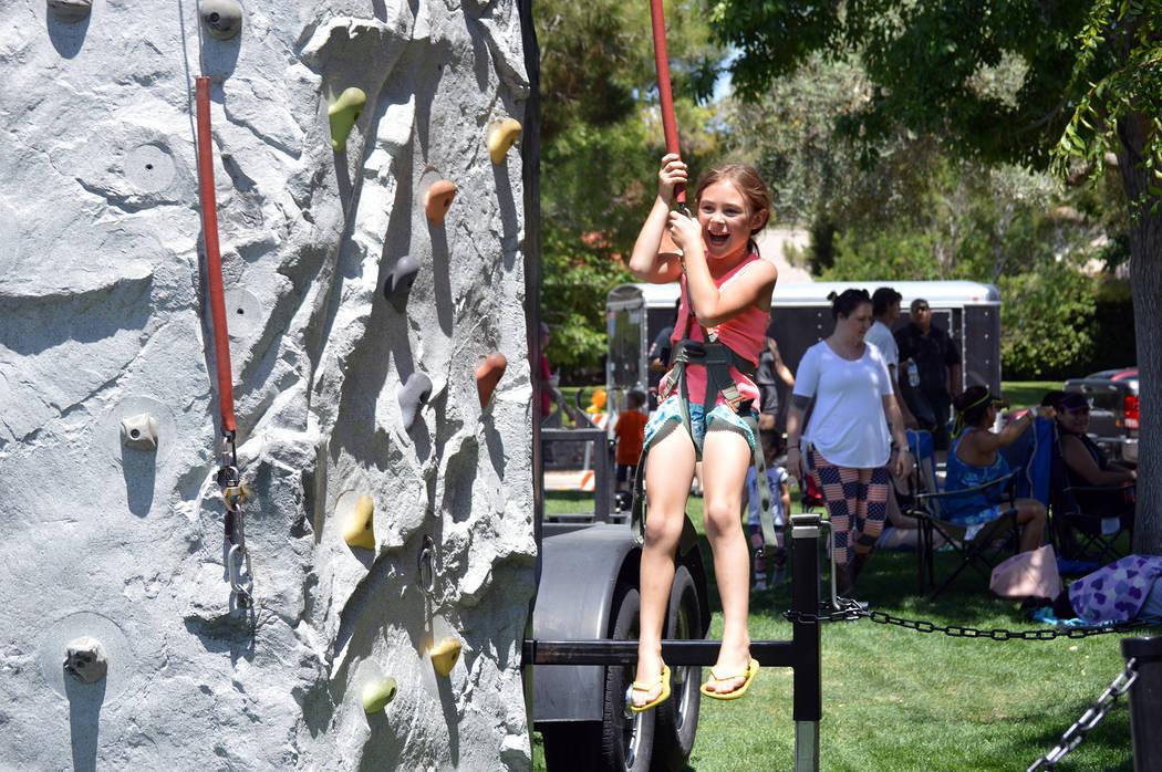 Celia Shortt Goodyear/Boulder City Review Savannah Challis enjoys the climbing wall on Saturday.