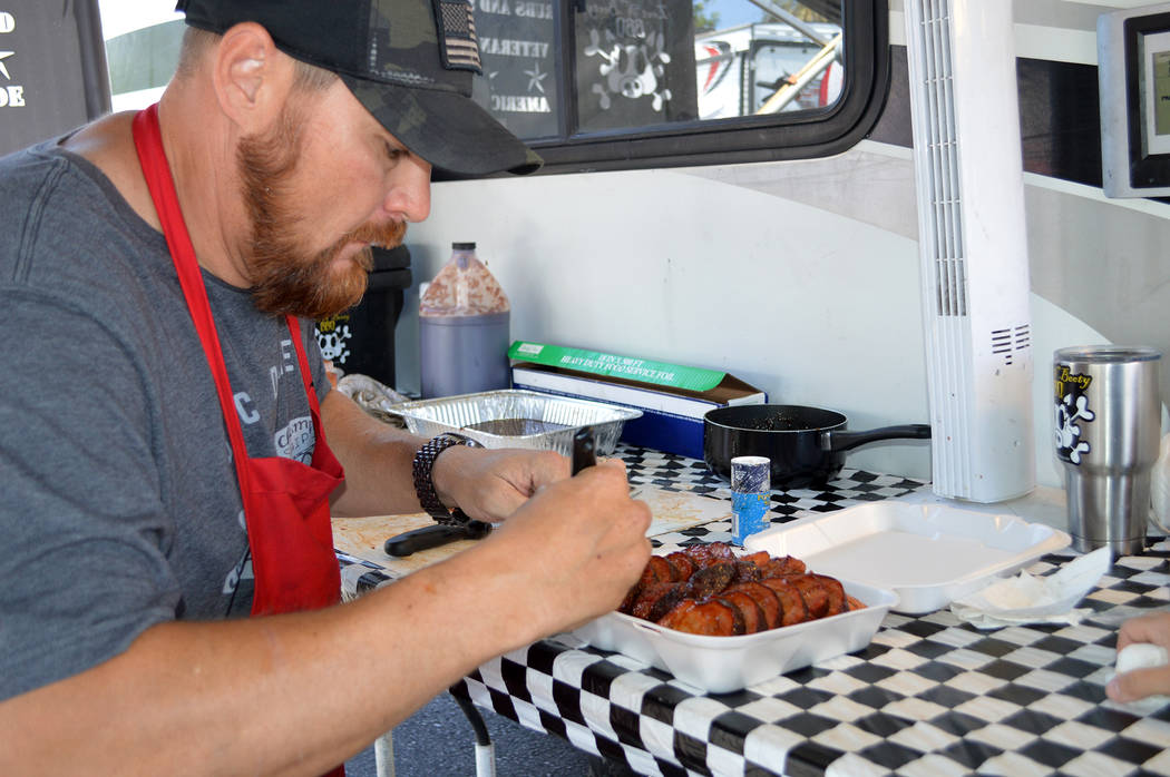 Celia Shortt Goodyear/Boulder City Review Sterling Smith, pitmaster of Loot N' Booty BBQ, prepares his pork shoulder for the judges at the Best Dam Barbecue Challenge on Saturday. This year was Sm ...