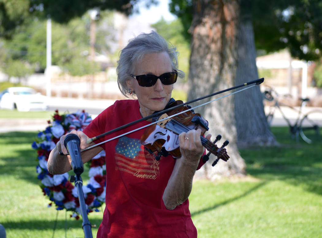 "Celia Shortt Goodyear/Boulder City Review Pam Murphy plays ""The Star-Spangled Banner"" at the American Legion Auxiliary's Memorial Day ceremony at Boulder City Cemetery."