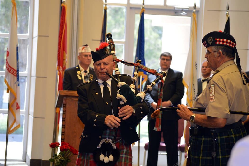 Celia Shortt Goodyear/Boulder City Review Dennis Hangey of Mesquite, a member of the Scottish American Military Society, plays the bagpipes during the Memorial Day ceremony on Monday at the Southe ...