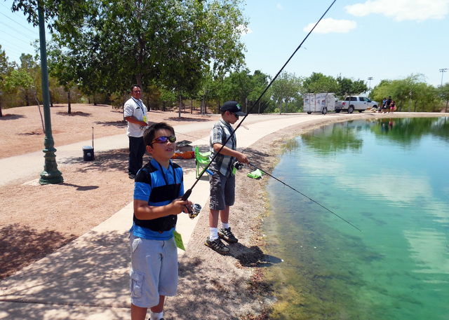 File Free fishing day will be observed Saturday throughout the state. Last year, brothers Kalvin, left, and Jameson Cabe, came from Henderson with their father and caught 15 catfish.