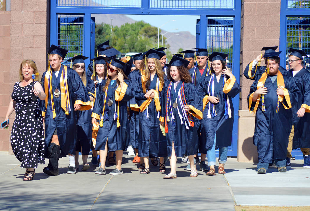 Celia Shortt Goodyear/Boulder City Review Boulder City High School Principal Amy Wagner leads the 2017 graduating class back to campus to conclude the 2017 Grad Walk.