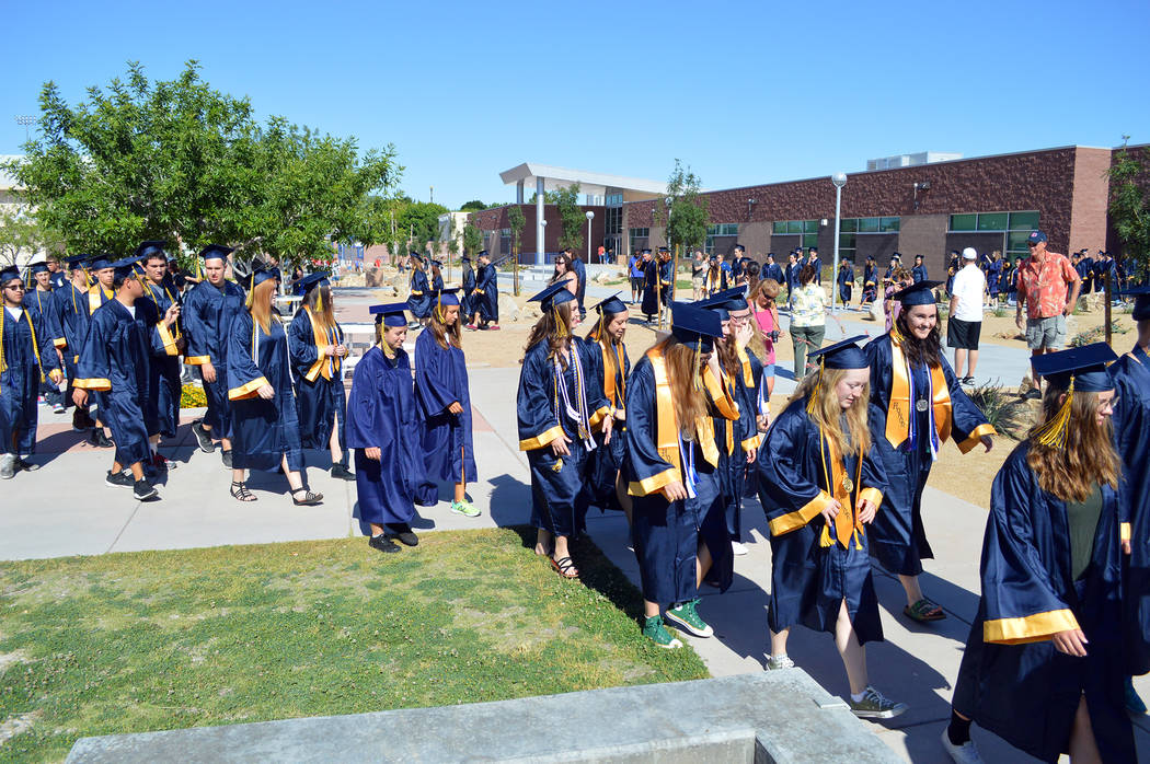 Celia Shortt Goodyear/Boulder City Review Members of the 2017 Boulder City High School graduating class walk through campus for this year's Grad Walk.