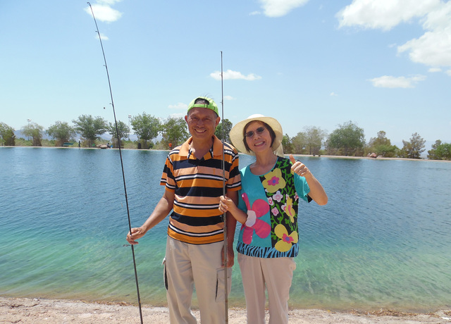 File Last year, Waising, left, and Chingchi Tsang didn't catch any fish, but said they had a great time during Free Fishing Day at the pond in Veterans' Memorial Park. This year's event will be he ...