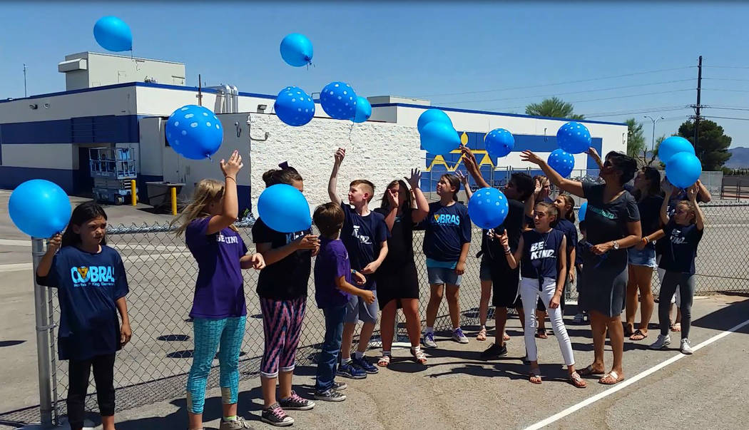 Celia Shortt Goodyear/Boulder City Review King Elementary students and Manteris family members release balloons on Monday in honor of Michael Manteris, a former King student who died at the end of ...