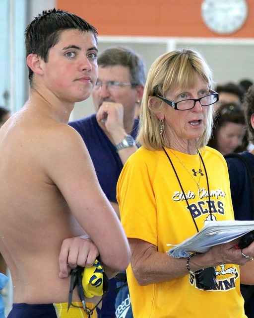 File Boulder City High School swim coach Sara Carroll, seen advising swimmer Nick Lara during a meet last year, was named boys swim coach of the year during the Best of Nevada Preps awards banquet ...