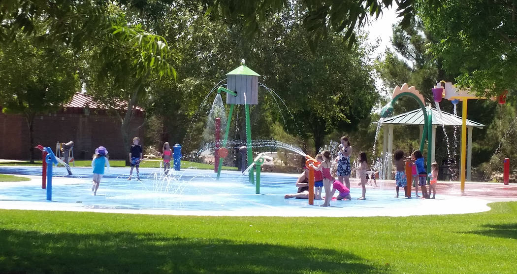 Celia Shortt Goodyear/Boulder City Review The extreme temperatures this week gave many kids and their parents a reason to use the Splash Park at Veterans' Memorial Park.