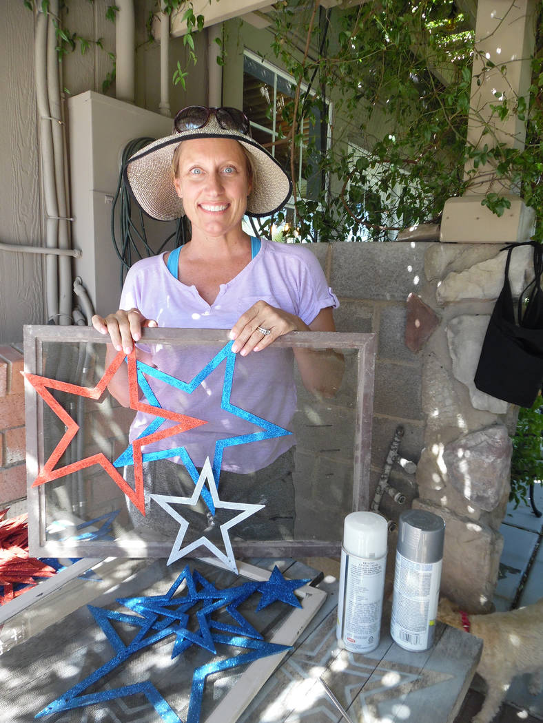 Hali Bernstein Saylor/Boulder City Review Tara Bertoli has transformed old screens from her home in the city's historic district into patriotic decorations in preparation for the annual Damboree.
