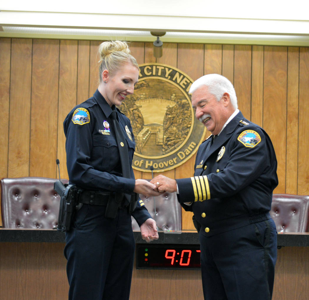 Celia Shortt Goodyear/Boulder City Review Boulder City Police Officer Tiffany Driscoll receives the department's Life Saver Award from Police Chief Tim Shea for her actions on Feb. 11 that saved a ...