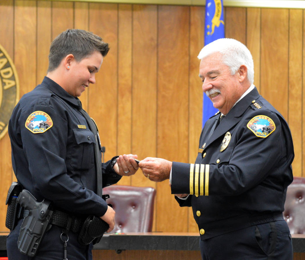 Celia Shortt Goodyear/Boulder City Review Boulder City Police Department's newest officer, Tonja Toumasis, receives a challenge coin from Police Chief Tim Shea on June 27 after she was sworn into  ...