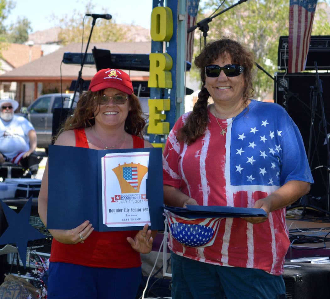 Celia Shortt Goodyear/Boulder City Review Marcela Fastow, left, of the Senior Center of Boulder City accepts the second-place award for best theme in the annual Damboree parade from Barbara Agosti ...