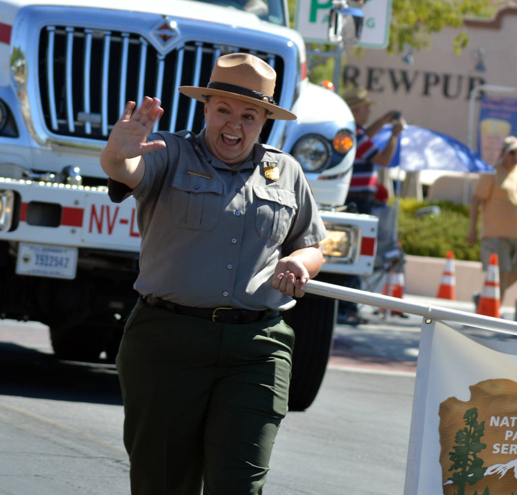 Celia Shortt Goodyear/Boulder City Review Chelsea Kennedy, public affairs specialist at Lake Mead National Recreation Area, greets those lining the street for the Fourth of July parade.