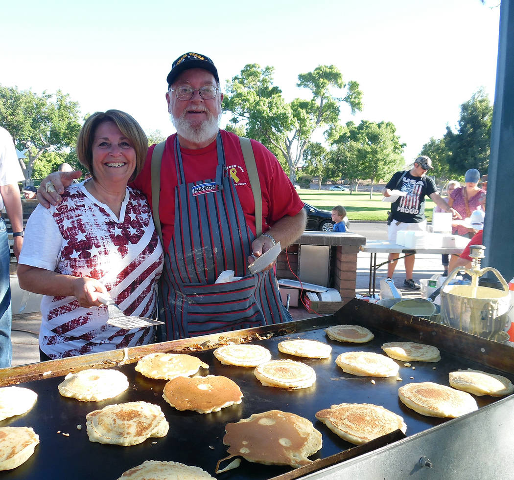 Hali Bernstein Saylor/Boulder City Review Jeanne Donadio and Duncan McCoy of the Rotary Club of Boulder City manned the grill for Tuesday's pancake breakfast. They expected to serve at least 600 f ...
