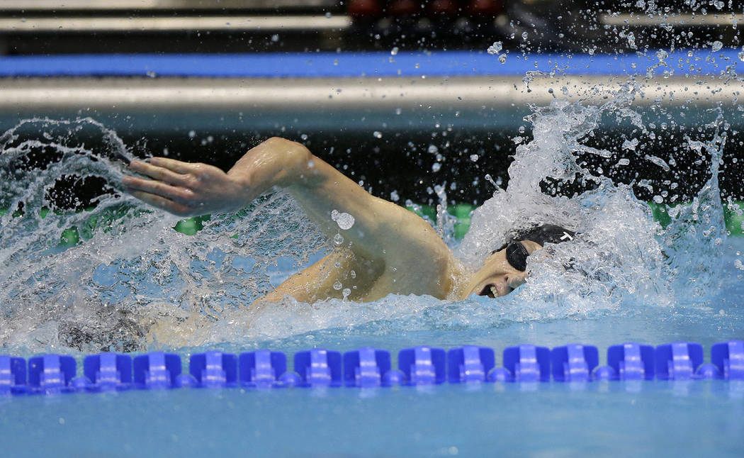 Michael Conroy/The Associated Press Zane Grothe swims on his way to winning men's 400-meter freestyle at the U.S. swimming national championships in Indianapolis on Friday. He is a 2010 graduate o ...