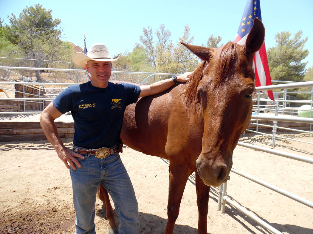 Hali Bernstein Saylor/Boulder City Review Boulder City Police officer Scott Pastore and his horse Odie, seen at his stable at the Boulder City Horseman's Association on July 6 make up the city's n ...
