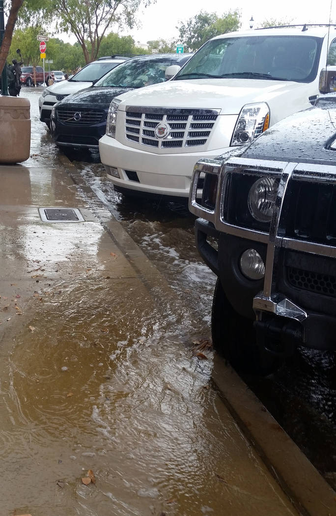 Celia Shortt Goodyear/Boulder City Review Despite efforts to reduce flooding in the city, monsoons, such as the one that hit Boulder City on Monday afternoon, can cause some water drainage issues.