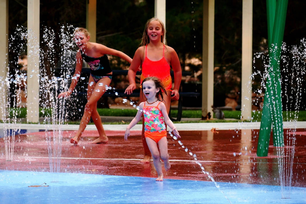 Paul Luisi/Boulder City Review Enjoying the cool waters of the splash park at Veterans' Memorial Park on a recent summer day were, from left, 10-year-old Haley Ferch, 10-year-old Lindsay Poe and 3 ...