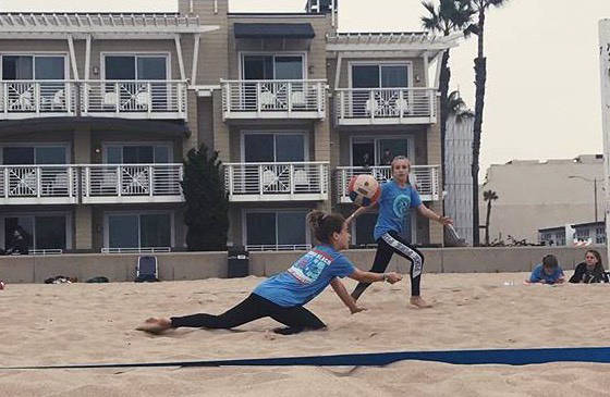 Madisen Wood 702 Volleyball player Zoey Robinson of Boulder City dives for the ball while her teammade Ava Wright looks on during a tournament in Hermosa Beach, California, in December.