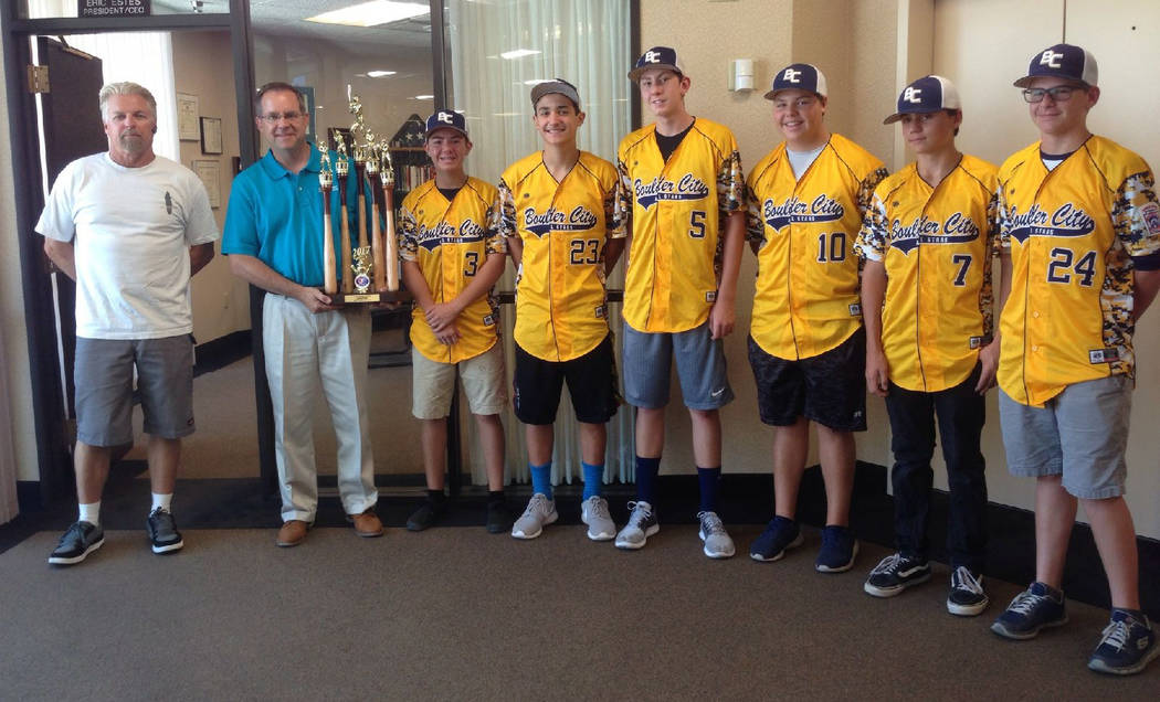 Don Trumble Boulder City Little League's All-Star junior team presents their trophy Monday to Eric Estes, second from left, president and CEO of Boulder Dam Credit Union, thanking them for their s ...