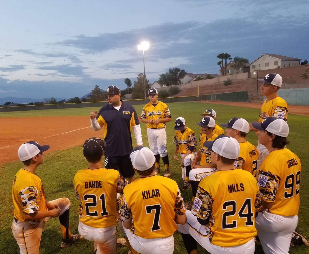 Don Trumble Coach Scott Bahde of the Boulder City Little League All-Stars juniors division, gives the team some last minute instructions before a recent game.