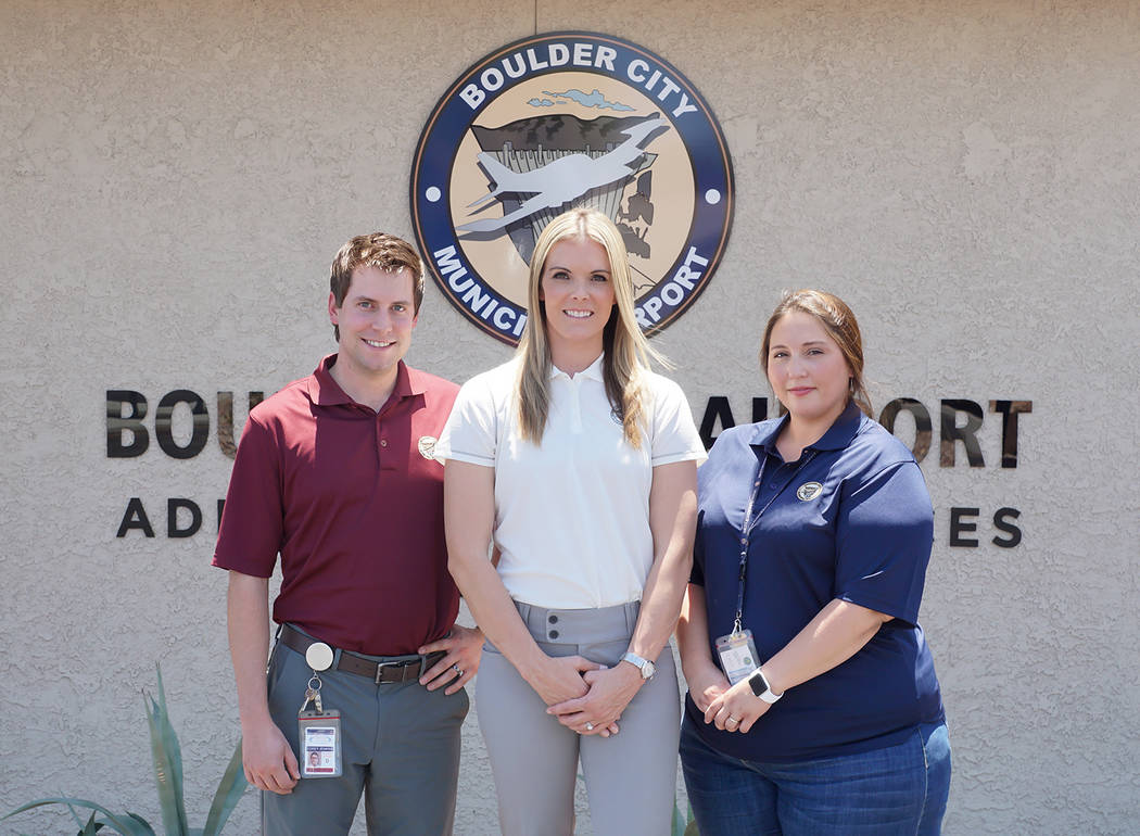 Boulder City Municipal Airport Boulder City Municipal Airport's new manager, Jennifer Lopez, center, completes the facility's operations team that also includes Corey Jenkins, left, airport operat ...