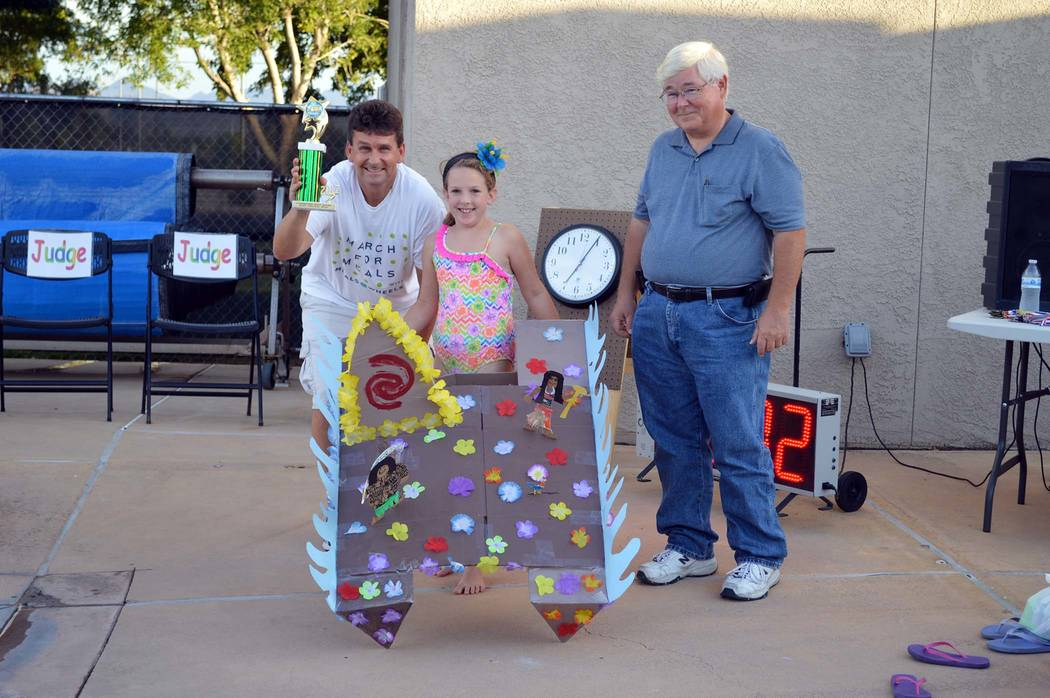 """Celia Shortt Goodyear/Boulder City Review Boulder City Mayor Rod Woodbury, left, and City Councilman Kiernan McManus, right, award 8-year-old Kallie Irwin with first prize in the """"Most Or ..."""